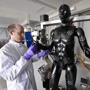 Jaime Cummins checks the Porton Man robot mannequin that will help test the next generation of chemical and biological suits for the UK's armed forces