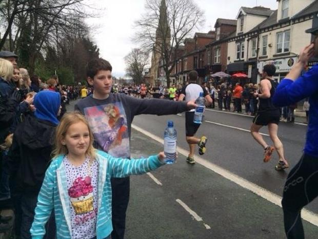 Thirty work – children hand out bottles of water to runners during Sunday's Sheffield half marathon