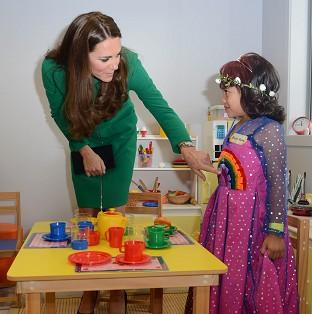 Halstead Gazette: The Duchess of Cambridge meets Bailey Taylor, six, during her visit to the Rainbow Place Children's Hospice in Hamilton, New Zealand