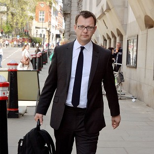Andy Coulson denies a charge of conspiring to hack phones