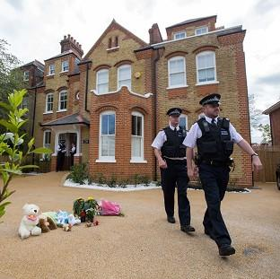 Halstead Gazette: Police at a house in New Malden, south London, after a woman was arrested following the discovery of three dead children