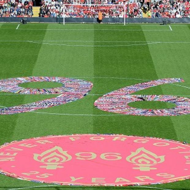 Halstead Gazette: Fans' scarves make up a 96, filling the centre circle before the Hillsborough 25th Anniversary Memorial Service at Anfield Stadium, Liverpool