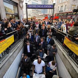 Halstead Gazette: People queue outside Oxford Circus underground station, in central London, during the rush hour as the Tube strike continues