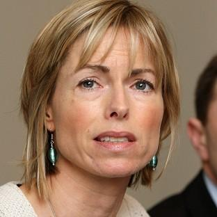 Kate McCann, pictured with husband Gerry, has urged people to sign up to Child Rescue Alerts
