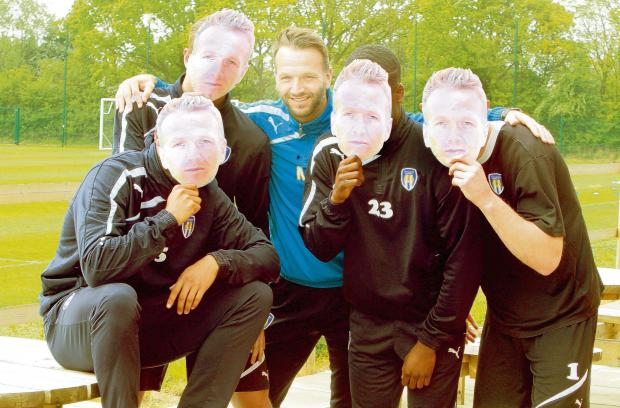 Face of a legend - U's player-coach Karl Duguid with his team-mates showing off the masks we will be printing in Friday's Daily Gazette, ahead of his final-ever game as a player. Picture: ADRIAN RUSHTON (CO93717-43)