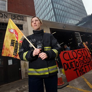 Firefighter Jes Bate at Euston fire station in London as firefighters staged a five hour strike in a row over pensions