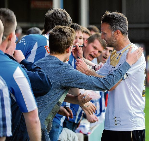 Halstead Gazette: One last time - Karl Duguid says goodbye to Colchester United fans following his last-ever playing appearance for the club at Walsall. Picture: WARREN PAGE
