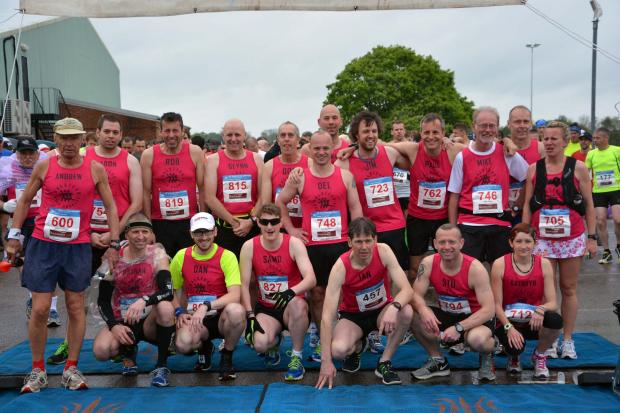 Halstead Gazette: Halstead Road Runners at the start of the race. Pic by Matthew Ranson