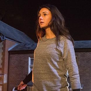 Coronation Street barmaid  Tina McIntyre, played by Michelle Keegan, as she plunges to the cobbles from the balcony of th