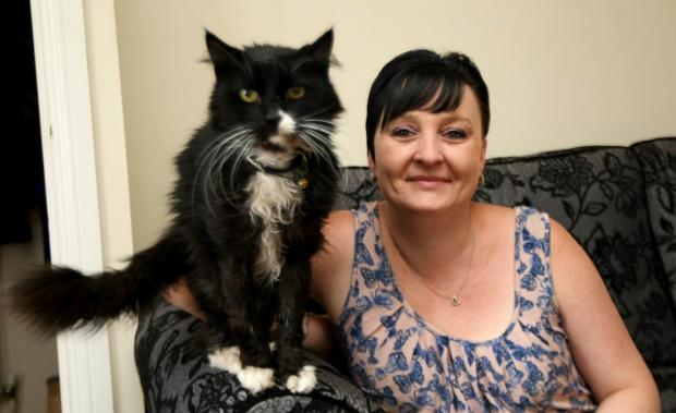 Sarah Fry with her cat Coco. Her other cat Blue died as a result of ingesting rat poison.