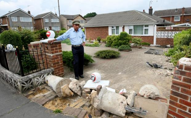 Fuming pensioner demands action after 13th crash into property