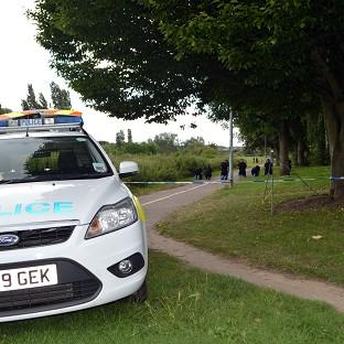 Halstead Gazette: Police search the scene at Salary Brook Trail in Colchester , Essex, where Nahid Almanea was attacked