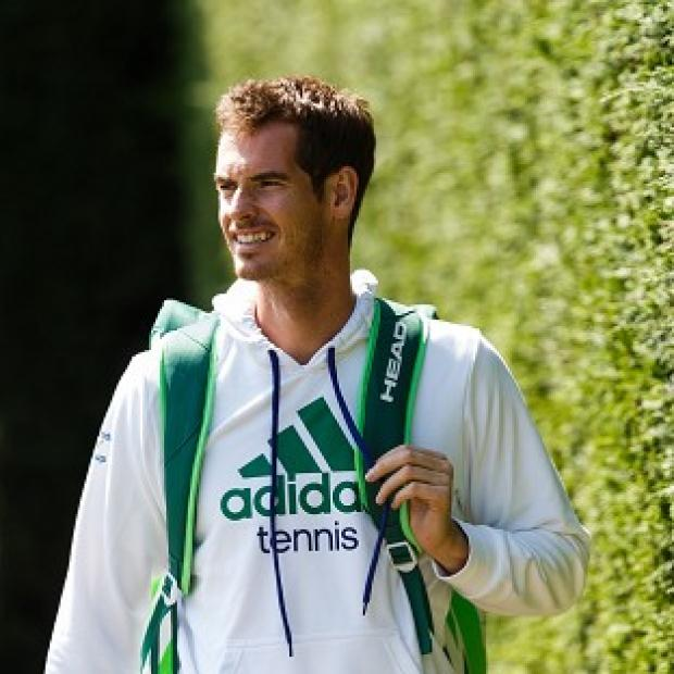 Halstead Gazette: Andy Murray arrives for the start of a practice session ahead of Wimbledon