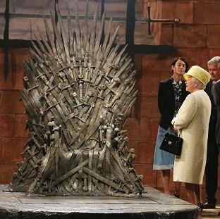 Halstead Gazette: The Queen during a visit to the set of Game of Thrones in Northern Ireland