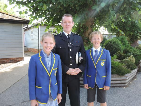 Chief Constable Stephen Kavanagh with the head boy and girl