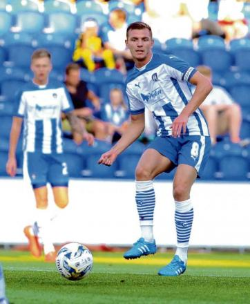 Forced off - Alex Gilbey was withdrawn at half-time after suffering a shin injury in Colchester United's pre-season friendly defeat against Ipswich Town. Picture: STEVE ARGENT (CO97129-09)
