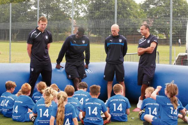 Watching brief - Colchester United's players pass on some advice to youngsters at the Football in the Community summer soccer camp at Shrub End. Picture: SEANA HUGHES (CO97512-10)