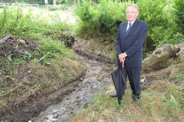 Rochford District Council's depoty leader, Keith Hudson, stands next to a dredged ditch in Hockley