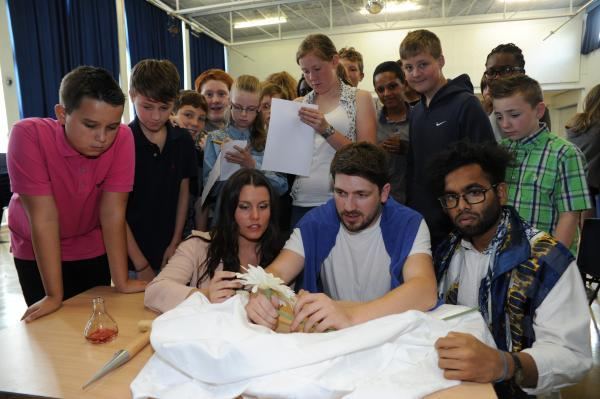 Following the clues – actors Jo Hughes, Tom Barker and Ruben Nathan, front, with youngsters enjoying a murder mystery-themed summer school at Beauchamps High School