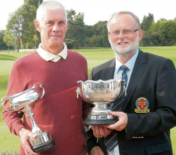 Alan Macnaught (left) gets his twin awards from Colchester Golf Club captain Tim Moriarty