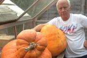 Adrian Wood with his oddly shaped pumpkin