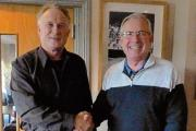 Winter League round six winner Bill Sharpe (right) collects his prize from the Essex seniors captain Norman Stechman.