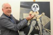 "Adult themes – artist Perry Sullivan with ""Pandemonium"", one of the pictures in his Eastgate exhibition"