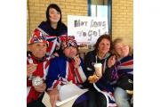 Royal fans Terry Hutt, John Loughry, Kathy Martin, Maria Scott and Amy Thompson enjoy luxury pastries sent to them by Kensington Palace