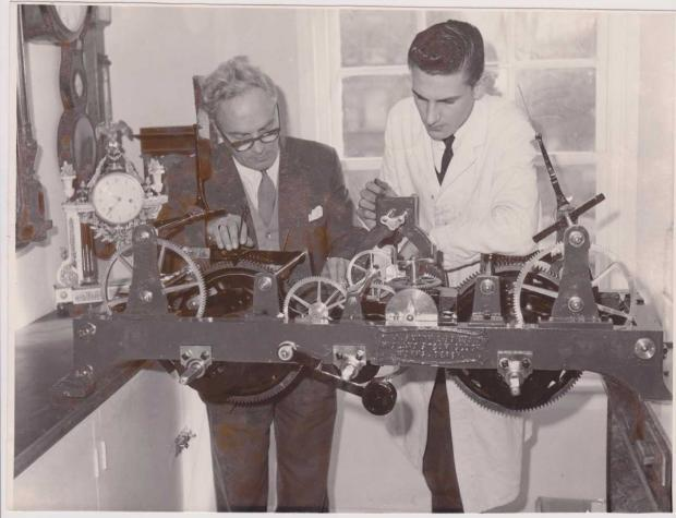Halstead Gazette: Experts - Reginald Upchurch (left) and Michael Drew, examining the turret clock from St Michael's Church, Myland, in 1961
