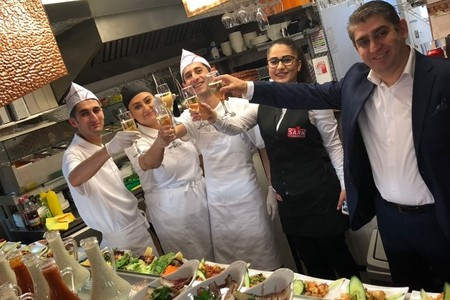 HAPPY ANNIVERSARY: Mr Barli and his team one year ago at their opening