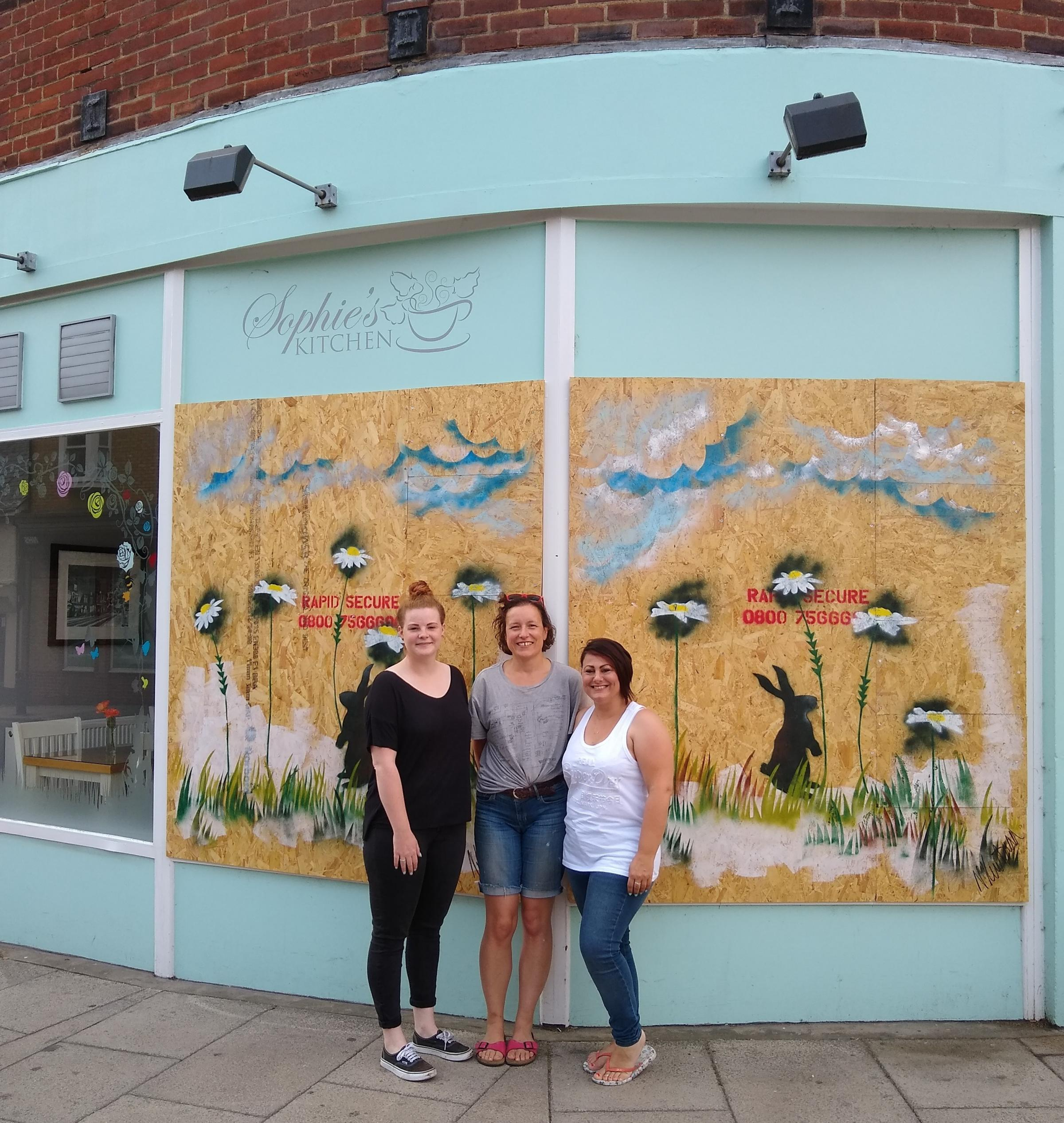 Community: Manager Sophie Hale, artist Natalie Huntsman and owner Sophie Spink outside the decorated shop front. Sophie's Kitchen is open for business as usual