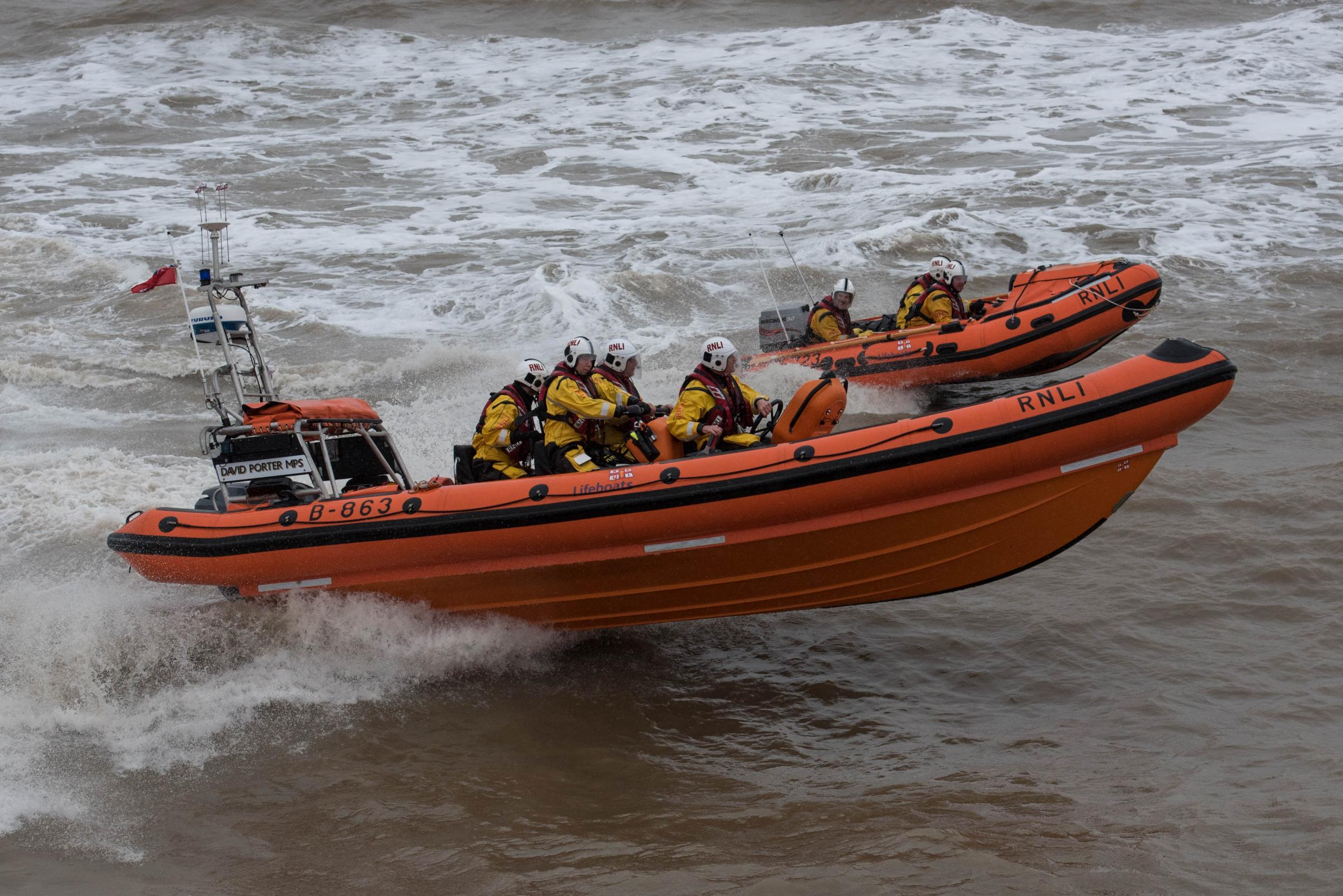 Lifeboat volunteers rescue sailors trapped after 20ft cruiser ran aground