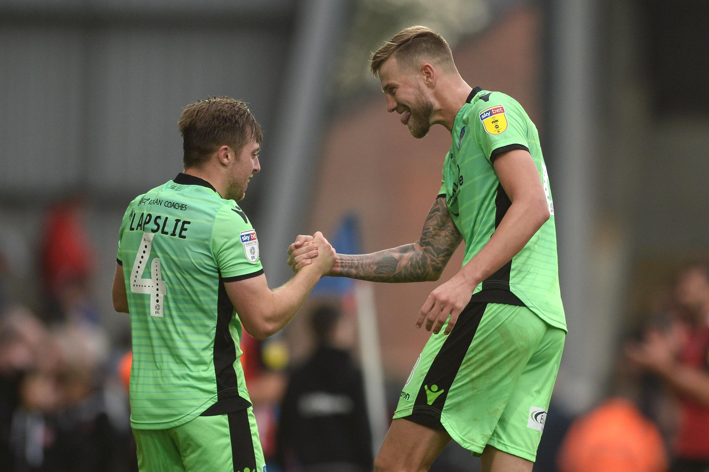 Harry Pell of Colchester United and Tom Lapslie of Colchester United celebrates at the final whistle - Morecambe vs. Colchester United - Sky Bet League Two - Globe Arena, Morecambe - 19/10/2018 - Photo by: Richard Blaxall.