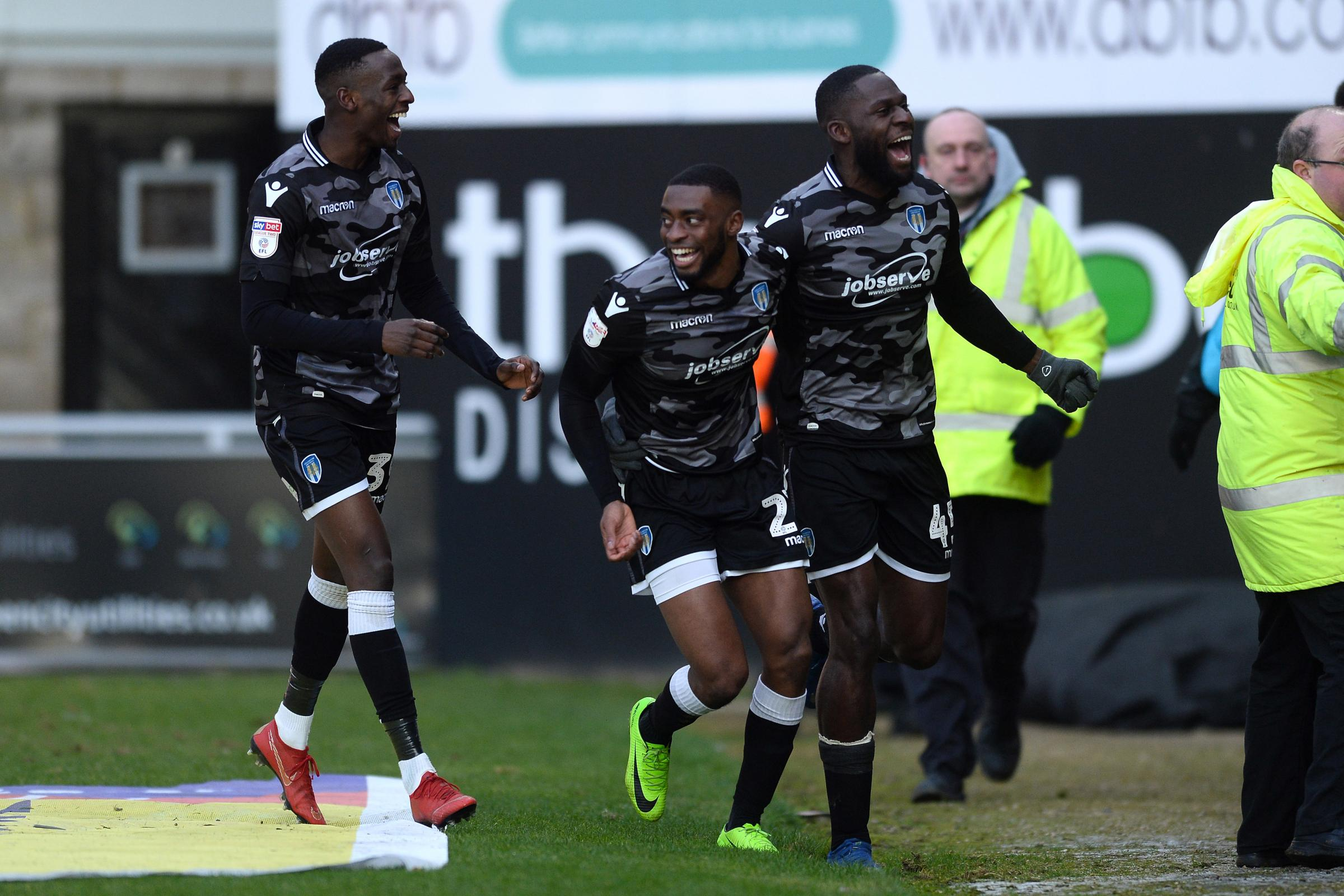 Away day - Kane Vincent-Young celebrates scoring at Northampton Town with team-mates Abo Eisa and Frank Nouble Picture: RICHARD BLAXALL