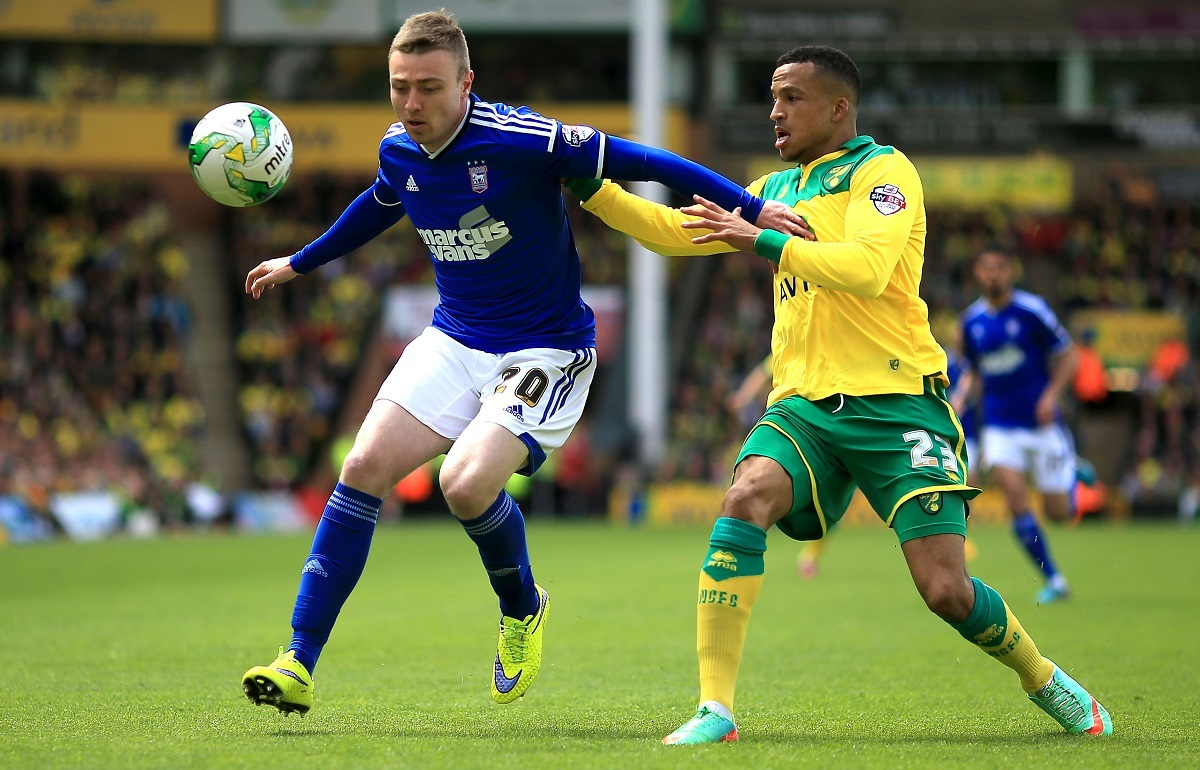 Norwich's Martin Olsson and Ipswich's Freddie Sears compete for the ball during the 2015 Championship play-offs