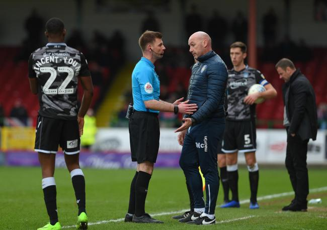 It's good to talk - Colchester United head coach John McGreal chats to a referee at Swindon Town Picture Pagepix.