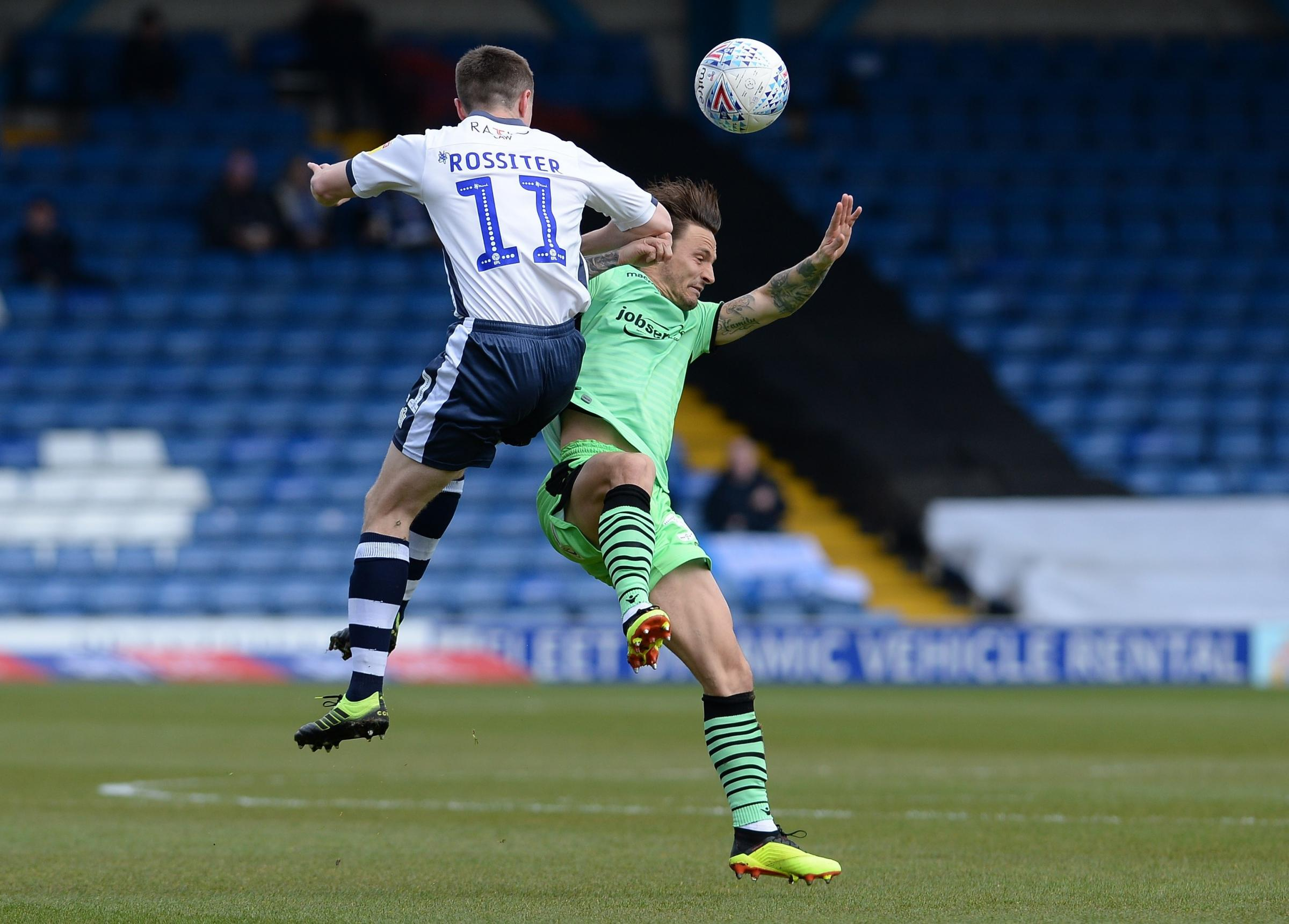 Challenge - Sam Saunders challenges for possession during Colchester United's 2-0 defeat at Bury Picture: PAGEPIX