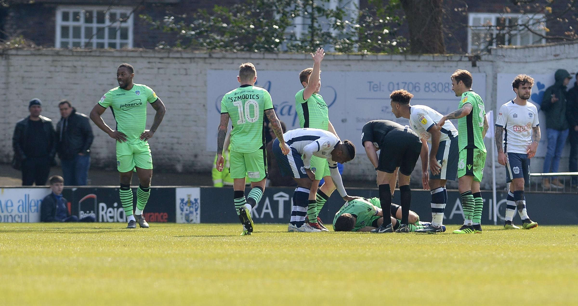 Setback - Colchester United captain Luke Prosser lies injured on the pitch at Bury  Picture: PAGEPIX
