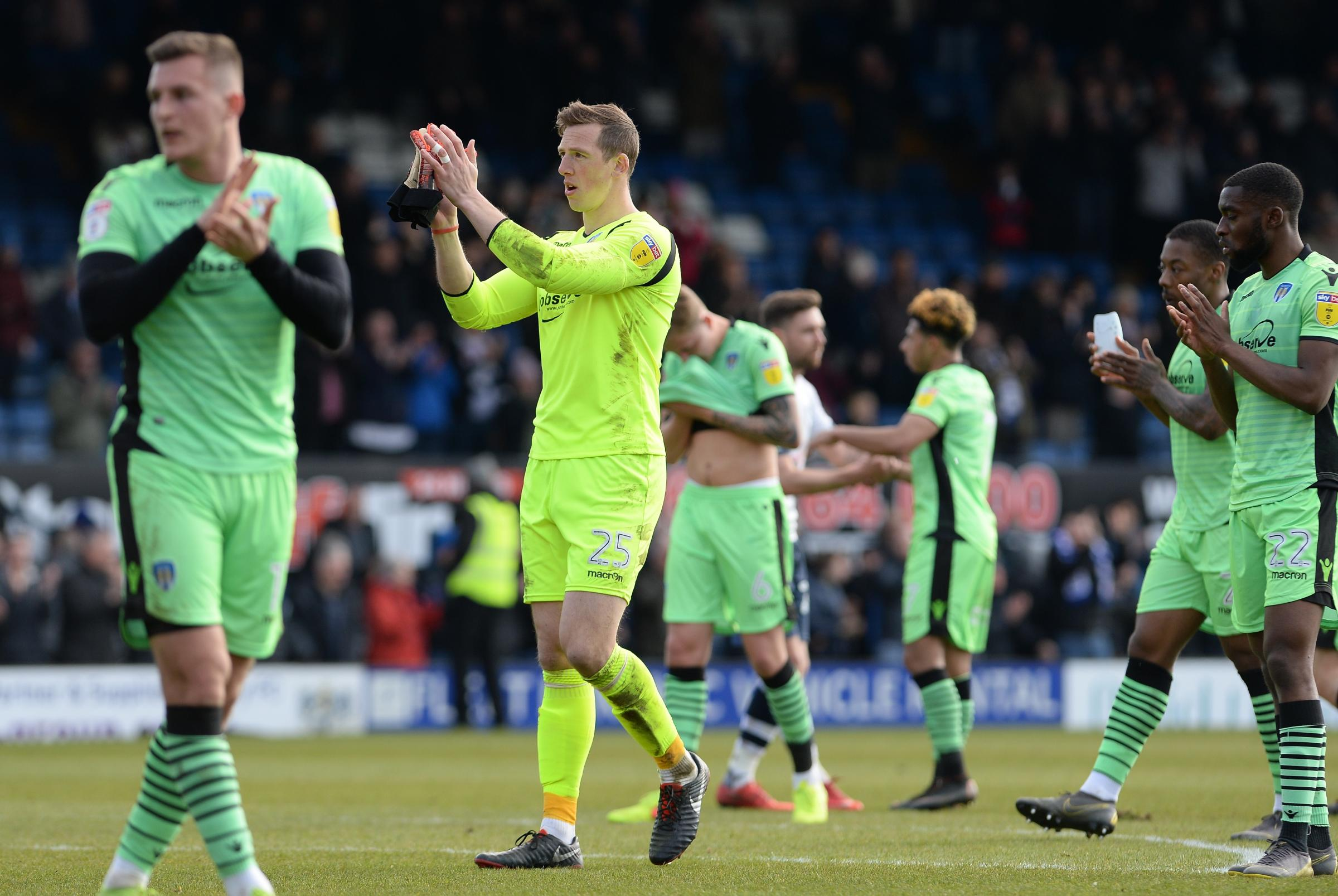 Thank you - Colchester United's players applaud their supporters following their 2-0 defeat at Bury Picture: PAGEPIX