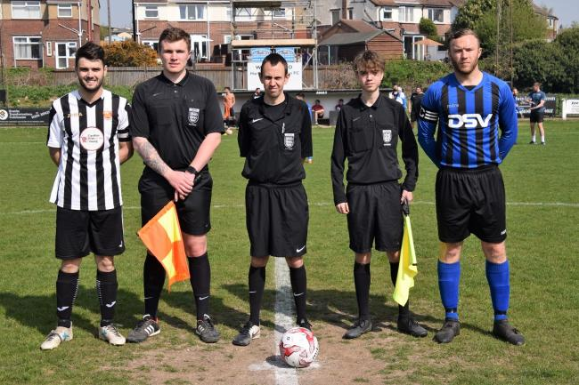 The Harwich and Oakley players shake hands before Monday's derby at the Royal Oak