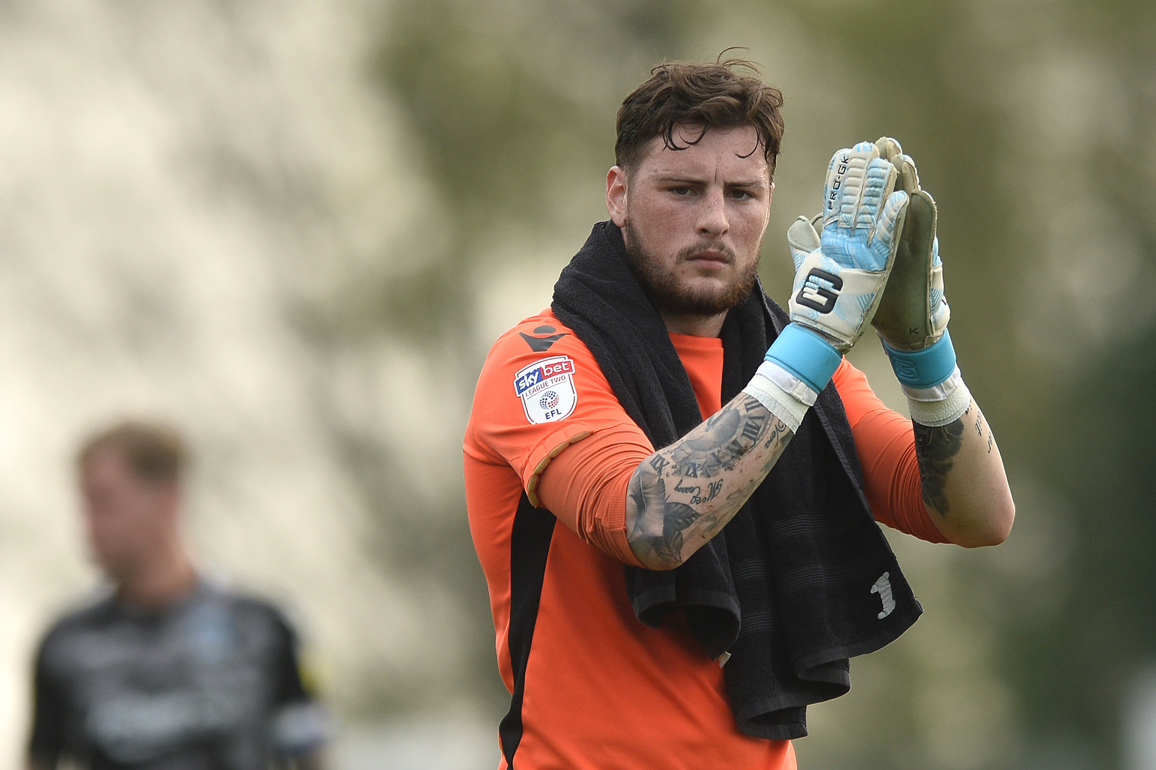 Gratitude - Colchester United keeper Ethan Ross applauds the fans after making his debut Picture: RICHARD BLAXALL