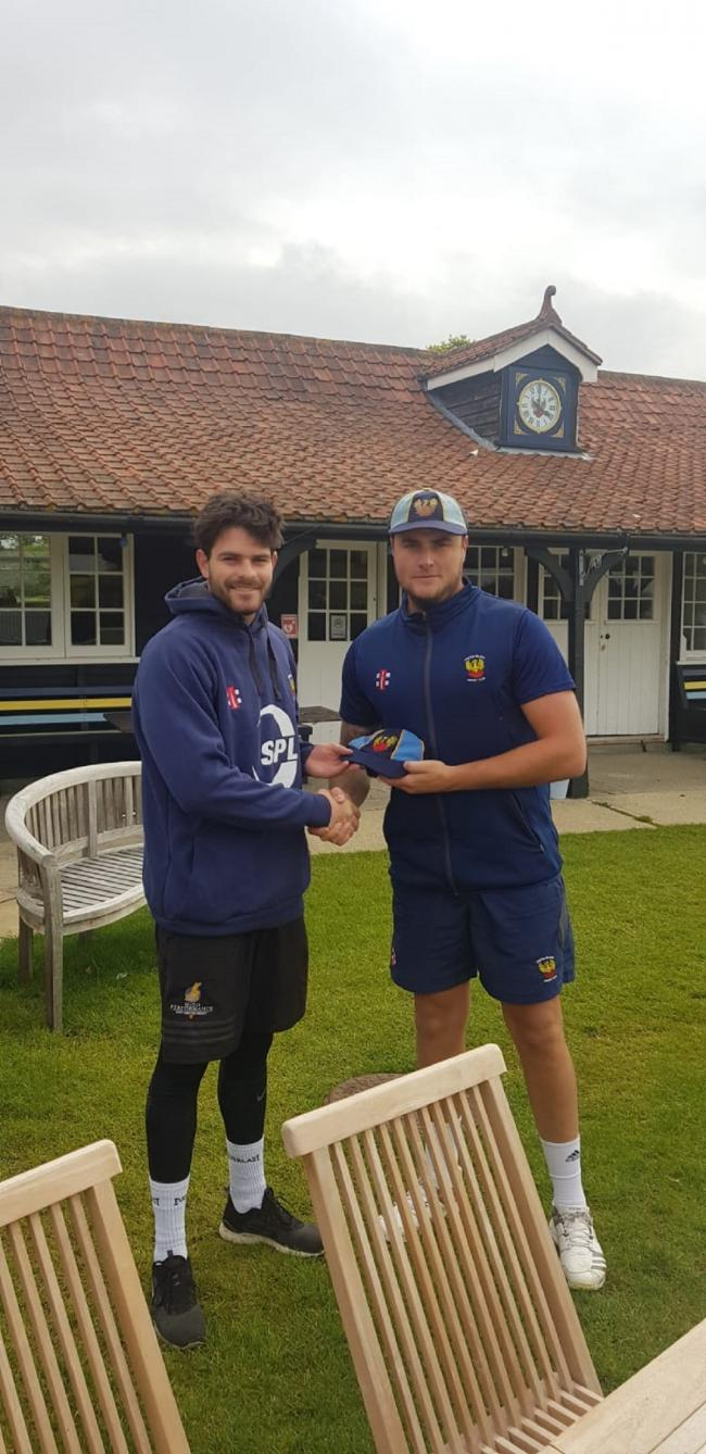 Blaine Bannister (left) receives his Frinton cap from skipper Mike Comber, having recently made his Premier League debut for the Ashlyns Road side.