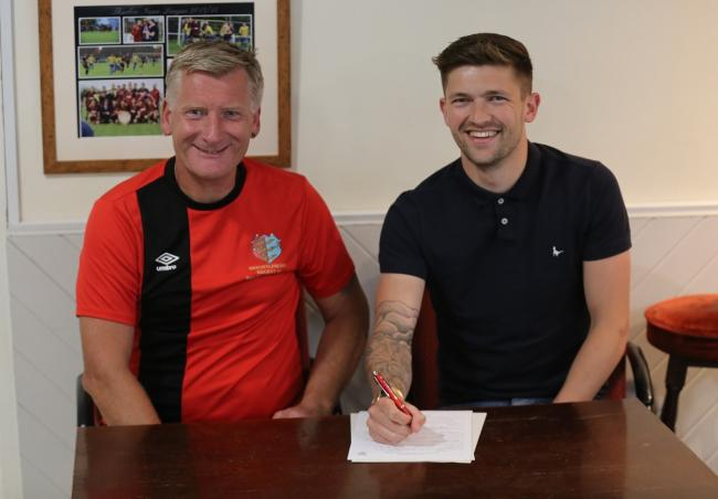 Two-year deal - Jake Turner and Regent kitman Alan Wright. Picture: Neil Payne