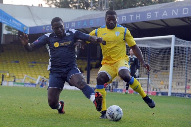 On the ball - George Elokobi (right) in action for Colchester United in their Sid Broomfield Trophy match at Southend United Picture: LUAN MARSHALL