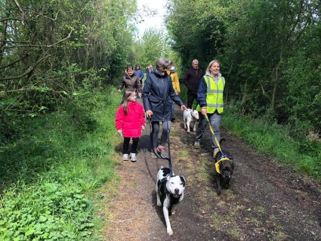 FURRY FRIENDS: The three mile walk raised more than £400 for the centre