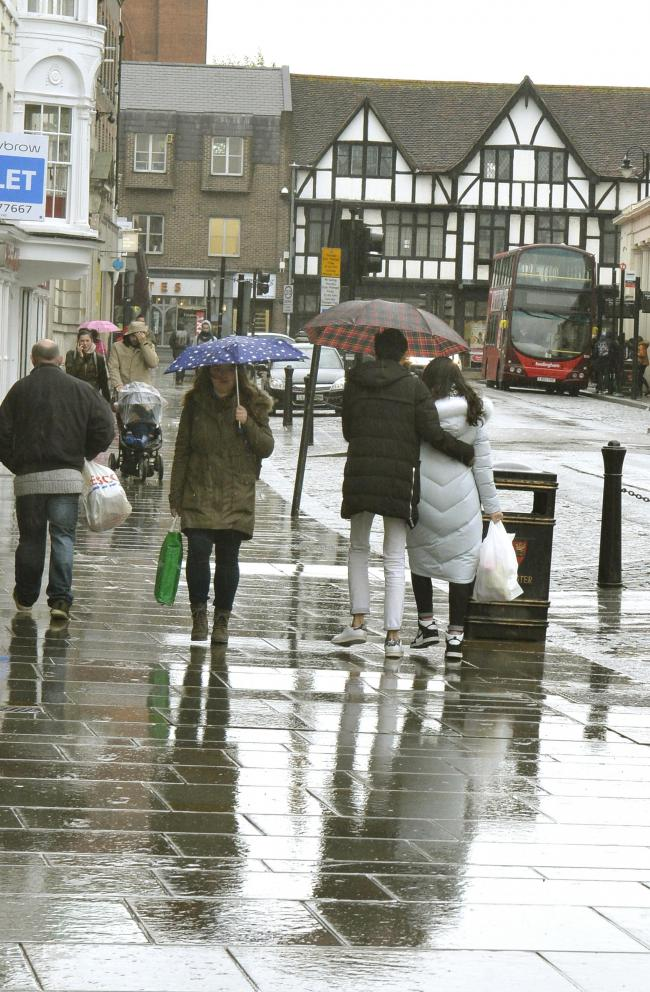 Weather rain..Shoppers in Colchester High Street..